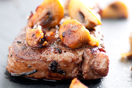 deliciously: deliciously grilled beef tenderloin steak done rare with sauteed mushrooms