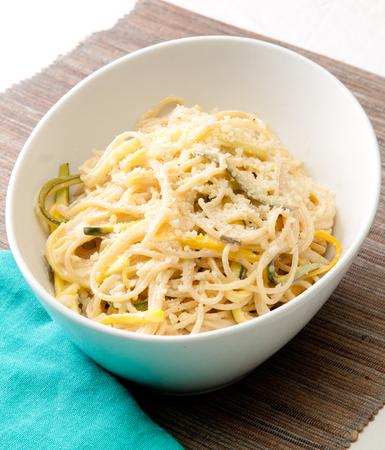 lactose intolerant: vegan zucchini pasta over gluten free noodles