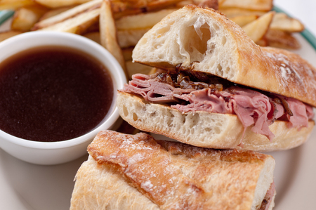 jus: classic french dip au jus or beef dip with fries Stock Photo