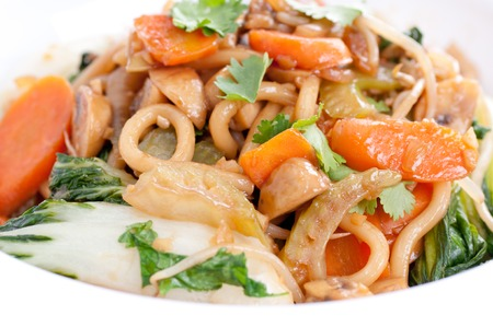 bok choy: vegetable stir fry with udon noodles and bok choy Stock Photo