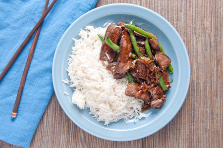 entree: spicy thai beef and green bean entree with white rice