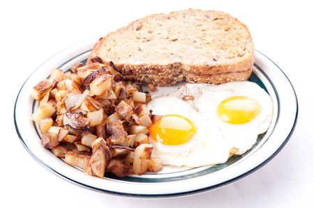 wheat toast: farm fresh eggs sunny side up with home fries and whole wheat toast
