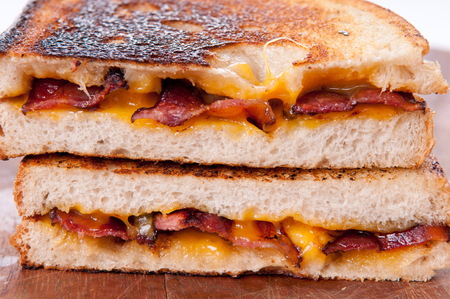 decadent: decadent grilled cheese and bacon sandwiches with oozing cheese running out