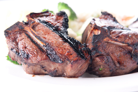 mutton chops: bbq lamb chops grilled to perfection with vegetable risotto Stock Photo