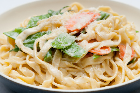 primavera: fettuccine alfredo primavera, creamy sauce with vegetables and home made pasta Stock Photo