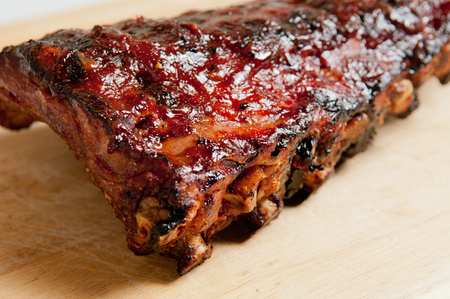 smothered: pork bbq ribs, meaty ribs smothered with bbq sauce Stock Photo