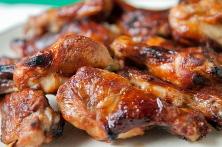 alitas de pollo: bbq chicken wings with sauce, grilled and tasty finger food