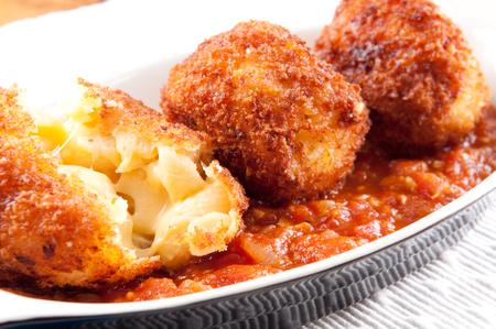marinara sauce: gooey macaroni and cheese balls with marinara sauce