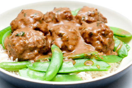 cooked pepper ball: honey garlic meatballs with white rice and snap peas with a nice sauce