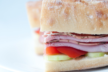 hoagie: rosemary ham sandwich on baguette with fresh tomato and cucumber