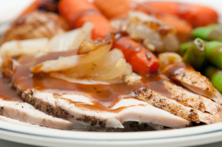 roasted: traditional turkey dinner with crispy skin, turkey slices and fresh roasted  vegetables smothered in gravy Stock Photo