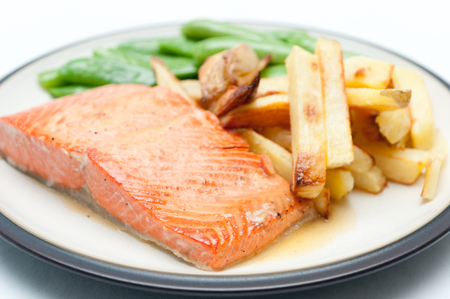 fighting cancer: maple glazed salmon fillet with french fries and snap peas, full of cancer fighting anti oxidants