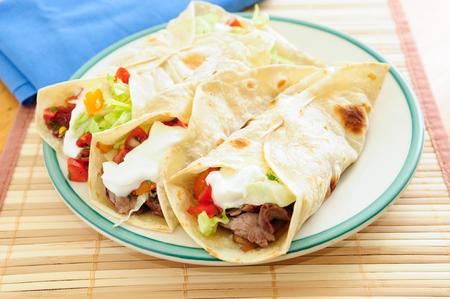 flank: home made beef tacos with flank steak, salsa and greek yogurt