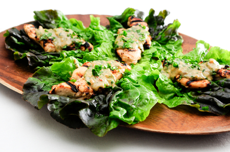 tenders: healthy barbequed chicken tenders wrapped in lettuce with a thai peanut sauce
