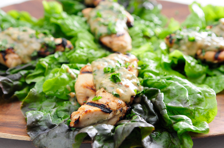 peanut sauce: healthy barbequed chicken tenders wrapped in lettuce with a thai peanut sauce