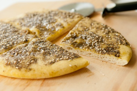 atar: zaatar flat bread, a lebanese or turkish bread made with sumac, sunflower seeds and thyme with olive oil on top.