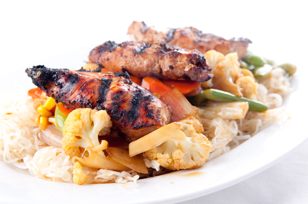 asian noodles: tender chicken with vegetables with crispy asian noodles and a sweet sauce