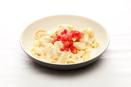 stuffed tortellini: creamy alfredo sauce with chicken stuffed tortellini topped with fresh diced tomato