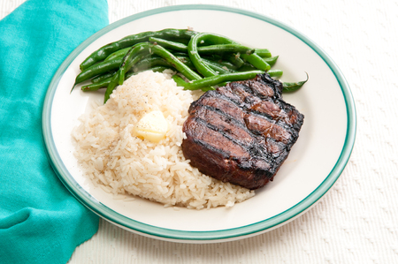 ethical: grilled organic pork chop with rice and green beans, from an ethical local farm