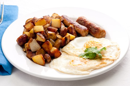 hashbrowns: farm fresh eggs and sausage with hand cut hashbrowns and sourdough toast Stock Photo