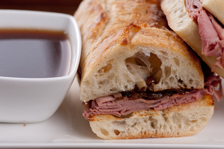 au: classic french dip au jus or beef dip with fries Stock Photo