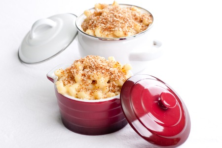 calorie rich food: macaroni and cheese noodles in single serving size with breadcrumb topping