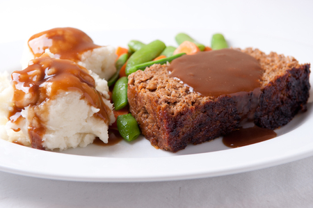 meatloaf: delicious meatloaf with mashed potatoes, gravy and fresh vegetables Stock Photo