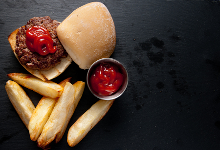 ground beef: hand ground beef burger with wedge potatoes stock photo