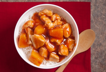 tangy: tangy sweet and sour chicken over white rice Stock Photo