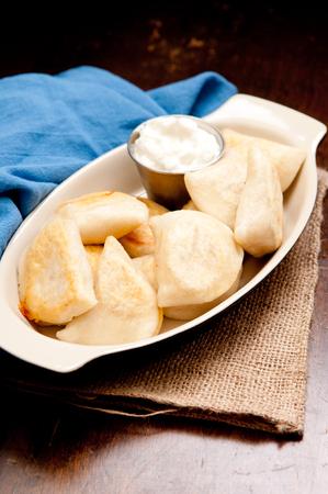 crispy pan fried pierogie or perogie wit heavy yogurt instead of sour cream