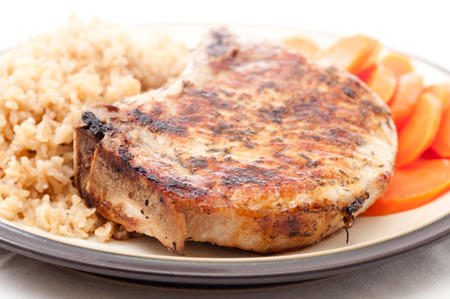 pork chop: crispy fried pork chop with carrots and rice