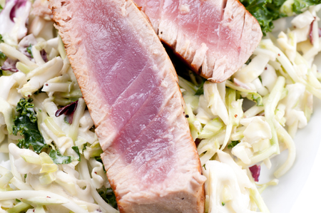 tunny: yellowfin tuna cooked rare with kale salad Stock Photo