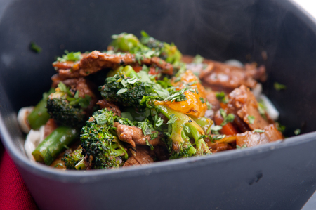 oranger beef stir fry with udon noodles Stock Photo