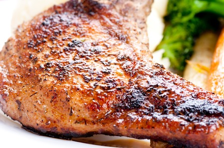 grilled pork rib chop with mashed potato and roasted carrot Stock Photo