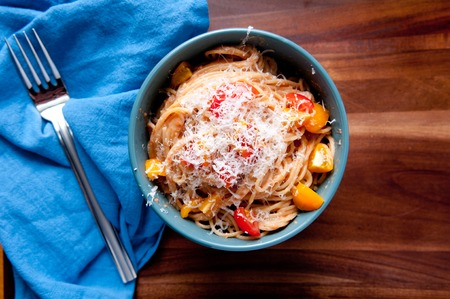 puttanesca: simple tomato vegetarian pasta with grated cheese
