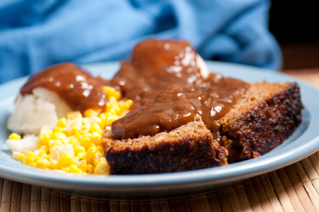 delicious meatloaf with mashed potatoes, gravy and fresh vegetables Stock Photo