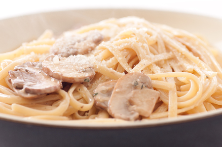 alfredo: linguine pasta with creamy alfredo sauce with parmesan and crimini mushrooms Stock Photo