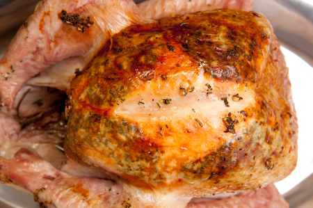 large roasted turkey free range, organic with sage, rosemary and butter stuffed under the skin Stock Photo
