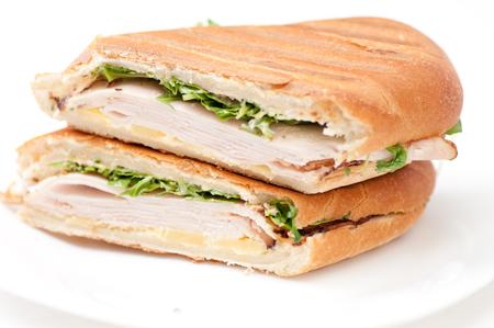 turkey panini with arugula and cheddar cheese