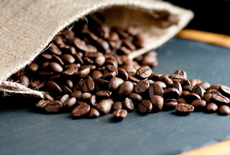 coffee beans from south america dark roasted on an artistic slate background Stock Photo