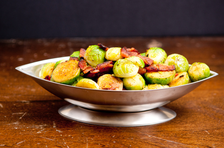 brussels sprouts: side dish of brussels sprouts with diced bacon for a holiday feast