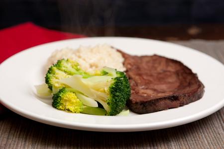 medium rare roast beef with creamy risotto and gravy Stock Photo