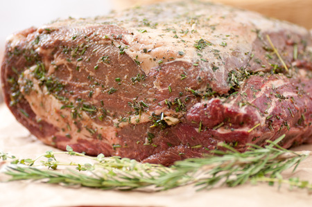 spice and herb crusted beef rib roast, raw and ready for the oven Stock Photo