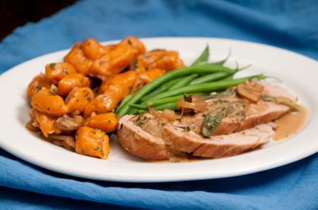 sweet potato gnocchi with pork tenderloin and mushroom sauce