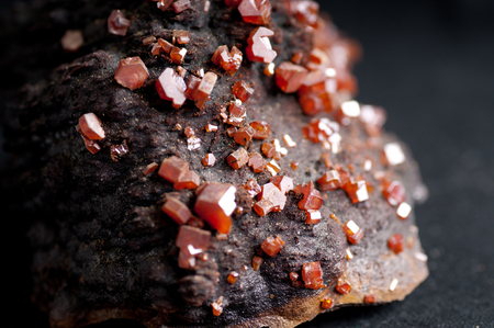 metamorphic: red vanadinite crystal mineral sample on metamorphic rock Stock Photo