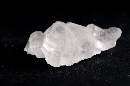 octahedral: fluorite, white crystal mineral sample of a gemstone with quartz