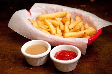 crinkle: crispy crinkle cut french fries with gravy and ketchup Stock Photo