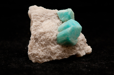 new age: some amazonite gemstone mineral stuck in granite