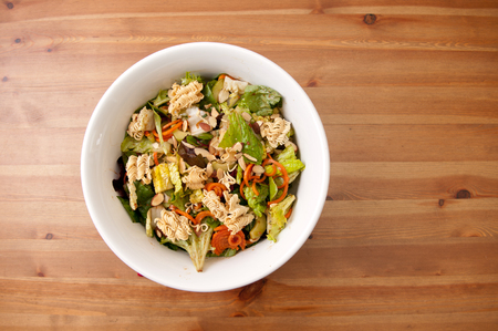 non vegetarian: toasted walnut, ramen and carrot salad with a healthy dressing Stock Photo
