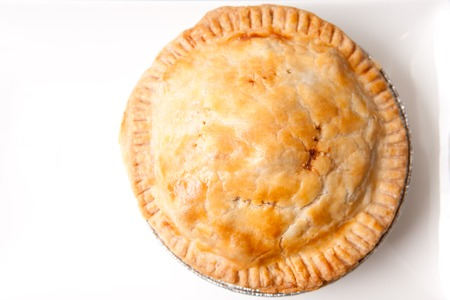hearty beef or lamb meat pie with flaky pastry and with salad